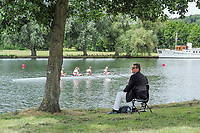 "Henley on Thames, United Kingdom, 23rd June 2018, Saturday,   ""Henley Women's Regatta"",  view, ""Crew Marshalling"" Sir Matthew  PINSENT, takes, Shade sitting under a tree, as he controls the crews through to the start area, Henley Reach, River Thames, England, © Peter SPURRIER"