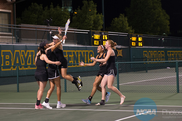 19 MAY 2015:  Members of the Vanderbilt women's tennis team rush to teammate Astra Sharma to celebrate winning The Division I Women's Tennis Championship at the Hurd Tennis Center on the Baylor University campus in Waco, TX.  Vanderbilt defeated UCLA 4-2 to win the team national title.  Darren Carroll/NCAA Photos