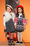 Models pose in outfits from the Charabia collection during the petitePARADE fashion show at Children's Club in the Jacob Javits Center in New York City on February 25, 2018.