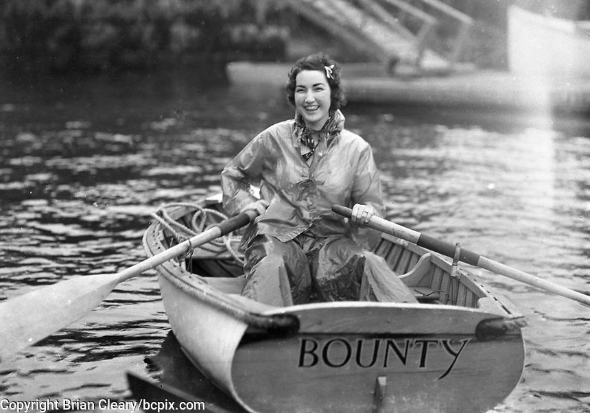"A girl in a rowboat named ""Bounty"". Boston Yacht Club circa 1936. (Photo by bcpix.com)"