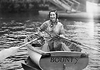 "A girl in a rowboat named ""Bounty"". Boston Yacht Club circa 1936. (Photo by bcpix.com)"