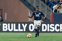 FOXBOROUGH, MA - AUGUST 31: Luis Caicedo #27 of New England Revolution passes the ball during a game between Toronto FC and New England Revolution at Gillette Stadium on August 31, 2019 in Foxborough, Massachusetts.