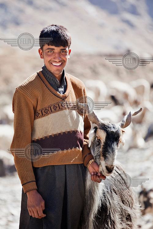 A portrait of a child goat herder.
