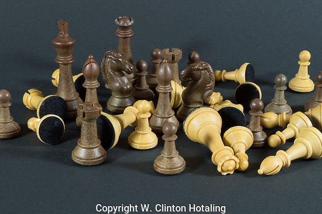 Chessmen have just a couple white pawns still standing.