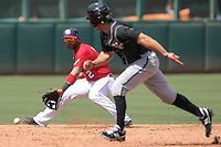 Oklahoma City RedHawks short stop Jonathan Villar (2) goes after a ground ball during the Pacific Coast League game against the at Chickashaw Bricktown Ballpark on June 23, 2013 in Oklahoma City ,Oklahoma.  (William Purnell/Four Seam Images)