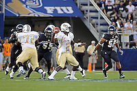 17 September 2011:  FIU linebacker Gregory Hickman (55) and linebacker Chris Edwards (56) rush UCF quarterback Jeff Godfrey (2) in the second quarter as the FIU Golden Panthers defeated the University of Central Florida Golden Knights, 17-10, at FIU Stadium in Miami, Florida.