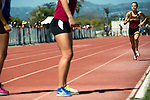 A Simi Valley High School female track and field team member runs towards her teammate in the final race of the day at Rio Mesa High School in Oxnard Calif., on Saturday, March 30 2013.