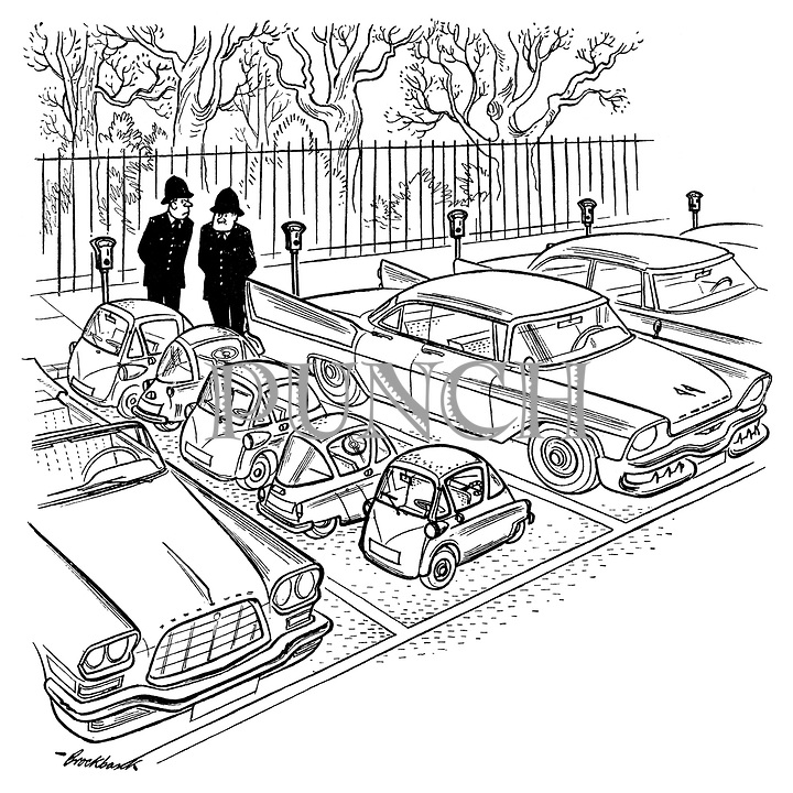 (Two policemen looking at a parked row of bubble cars)