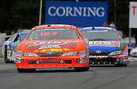 Aug. 8, 2009; Watkins Glen, NY, USA; NASCAR Nationwide Series driver Marcos Ambrose (47) leads Kyle Busch (18) during the Zippo 200 at Watkins Glen International. Mandatory Credit: Mark J. Rebilas-
