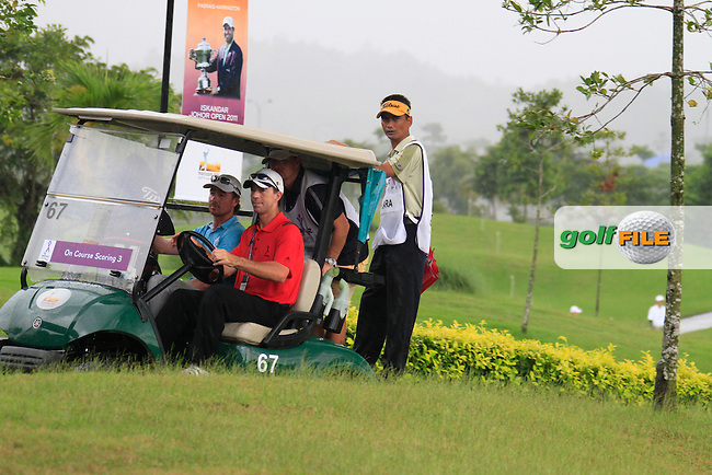 Brett Rumford (AUS) arrives back at the clubhouse as the heavens open yet again as monsoon rains fall during Saturday's storm delayed  Round 3 of the Iskandar Johor Open 2011 at the Horizon Hills Golf Resort Johor, Malaysia, 19th November 2011 (Photo Eoin Clarke/www.golffile.ie)