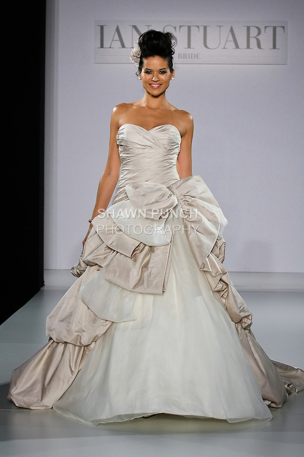 Model walks runway in a South Pacific wedding dress from the Ian Stuart - Supernova Bridal Collection 2013 fashion show, at the Couture Show during New York Bridal Fashion Week, October 14, 2012.