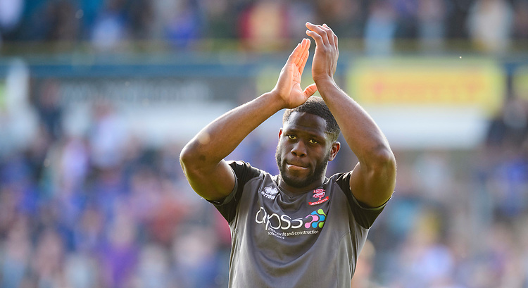 Lincoln City's John Akinde applauds the fans at the final whistle<br /> <br /> Photographer Chris Vaughan/CameraSport<br /> <br /> The EFL Sky Bet League Two - Carlisle United v Lincoln City - Friday 19th April 2019 - Brunton Park - Carlisle<br /> <br /> World Copyright © 2019 CameraSport. All rights reserved. 43 Linden Ave. Countesthorpe. Leicester. England. LE8 5PG - Tel: +44 (0) 116 277 4147 - admin@camerasport.com - www.camerasport.com