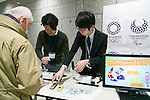 Members of staff collect old mobile phones from a donor at Tokyo Metropolitan Government Building on February 21, 2017, Tokyo, Japan. Tokyo Government has asked for people to donate their old electronic gadgets (including smart phones, mobile phones and tablets) with the aim of collecting and recycling eight tonnes of gold, silver and bronze to make the 5,000 medals needed for the 2020 Tokyo Olympic and Paralympic Games. The recycling campaign started on Thursday, February 16. (Photo by Rodrigo Reyes Marin/AFLO)