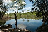 Aldeia Baú, Para State, Brazil. The Curua River with rainforest; an aluminium voadeira boat.