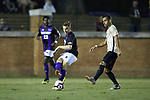 Ryan Inman (4) of the High Point Panthers kicks the ball away from Bruno Lapa (10) of the Wake Forest Demon Deacons during first half action at W. Dennie Spry Soccer Stadium on October 9, 2018 in Winston-Salem, North Carolina. The Demon Deacons defeated the Panthers 4-2.  (Brian Westerholt/Sports On Film)