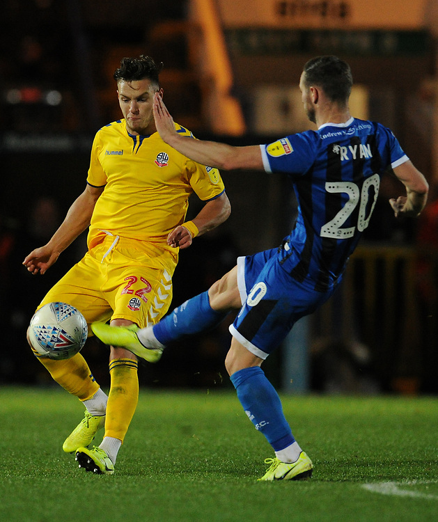 Bolton Wanderers' Dennis Politic vies for possession with Rochdale's Jimmy Ryan<br /> <br /> Photographer Kevin Barnes/CameraSport<br /> <br /> EFL Leasing.com Trophy - Northern Section - Group F - Rochdale v Bolton Wanderers - Tuesday 1st October 2019  - University of Bolton Stadium - Bolton<br />  <br /> World Copyright © 2018 CameraSport. All rights reserved. 43 Linden Ave. Countesthorpe. Leicester. England. LE8 5PG - Tel: +44 (0) 116 277 4147 - admin@camerasport.com - www.camerasport.com