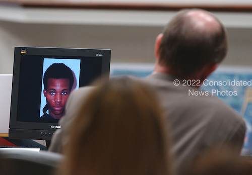 A photograph of sniper suspect Lee Boyd Malvo is displayed on a computer screen during testimony in the trial of sniper suspect John Allen Muhammad in courtroom 10 at the Virginia Beach Circuit Court in Virginia Beach, Virginia on October 30, 2003. <br /> Credit: Adrin Snider - Pool via CNP