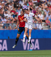 REIMS,  - JUNE 24: Alexia Putellas #11 goes up for a header with Kelley O'Hara #5 during a game between NT v Spain and  at Stade Auguste Delaune on June 24, 2019 in Reims, France.