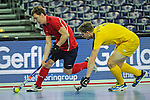 Leipzig, Germany, February 08: Marat Khairullin #3 of Russia dribbles the ball during the placement match (5th / 6th) between Sweden (yellow) and Russia (red) on February 8, 2015 at the FIH Indoor Hockey World Cup at Arena Leipzig in Leipzig, Germany. Final score 1-3 (1-0). (Photo by Dirk Markgraf / www.265-images.com) *** Local caption *** Marat Khairullin #3 of Russia, Henry Eriksson #3 of Sweden