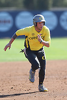 A.J. Balta #33 of the Oregon Ducks runs the bases during a game against the Loyola Marymount Lions at Page Stadium on February 23, 2014 in Los Angeles, California. Oregon defeated Loyola, 4-3. (Larry Goren/Four Seam Images)