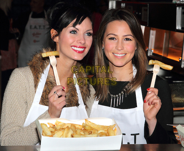 Jessica Jane Clement & Rachel Stevens .The EATT (Eat At The Table) Launch Photocall - an Annual Event to feed the Homeless - at Golden Union Fish Bar, Oxford Street, London, England..February 8th 2012.half length black beige top white apron food fries chips fork fur .CAP/ROS.©Steve Ross/Capital Pictures