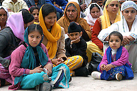 """Rome April 30 2006  .Piazza Vittorio  .Sikh """"Punj Pyare"""" (Five Beloved Ones) lead a religious parade.The parade is for Visaki, a traditional Sikh celebration..Women and Sikh children  ."""
