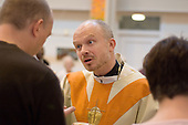 Reverend Graham Buckle conducts the Sunday morning service at St.Paul's Church Centre, Lisson Green, London.