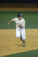 Wake Forest Demon Deacons pinch-runner Seth Constable (2) takes off for third base during the game against the UConn Huskies at Wake Forest Baseball Park on March 17, 2015 in Winston-Salem, North Carolina.  The Demon Deacons defeated the Huskies 6-2.  (Brian Westerholt/Four Seam Images)