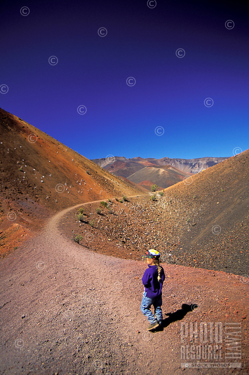 Young girl walking in Haleakala National park, Maui