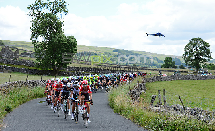 Picture by Alex Broadway/SWpix.com - 05/07/2014 - Cycling - Tour de France 2014 Grand Depart - Stage 1, Leeds to Harrogate - Yorkshire, England - The Peloton makes it way through the Yorkshire Dales on Stage 1.