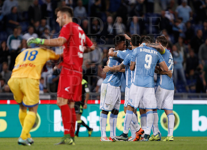 Calcio, Serie A: Lazio vs Frosinone. Roma, stadio Olimpico, 4 ottobre 2015.<br /> Lazio&rsquo;s Filip Djordjevic, second from right, celebrates with teammates after scoring as Frosinone&rsquo;s Federico Dionisi, left, and Nicola Leali react during the Italian Serie A football match between Lazio and Frosinone at Rome's Olympic stadium, 4 October 2015.<br /> UPDATE IMAGES PRESS/Isabella Bonotto