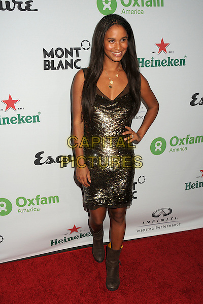 "JOY BRYANT .Oxfam America and Esquire House LA Host ""The Oxfam Party"" held at Esquire House LA, Los Angeles, California, USA, .18th November 2010..full length gold dress bronze sequined sequin sleeveless hand on hip boots brown ankle biker .CAP/ADM/BP.©Byron Purvis/AdMedia/Capital Pictures."
