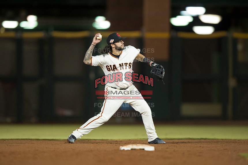 Scottsdale Scorpions second baseman C.J. Hinojosa (8), of the San Francisco Giants organization, throws to first base during an Arizona Fall League game against the Mesa Solar Sox on October 9, 2018 at Scottsdale Stadium in Scottsdale, Arizona. The Solar Sox defeated the Scorpions 4-3. (Zachary Lucy/Four Seam Images)