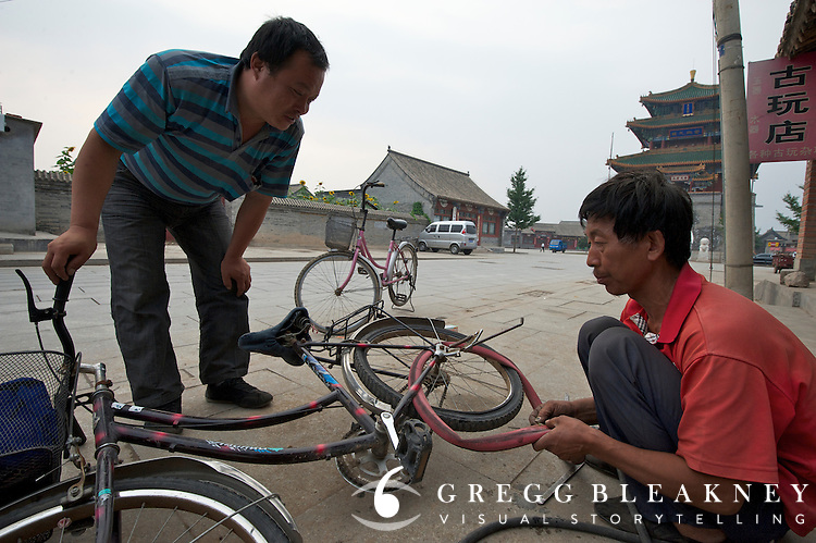 A bicycle repairman in stage 3's finish host town, Yongning - Stage Three, 162km, Shangyu island to Yongning Town via Thirteen Ming Tombs Reservoir - 2011 Tour of Beijing Scouting Photos
