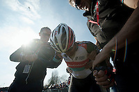 111th Paris-Roubaix 2013..Fabian Cancellara (CHE) exhausted after winning his 3rd Paris-Roubaix. Helped back up by press officer Tim Vanderjeugd & DS Dirk Demol..