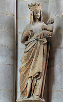 Statue of La Vierge Doree or the Gilded Virgin, removed from the exterior of the South transept and placed inside the Basilique Cathedrale Notre-Dame d'Amiens or Cathedral Basilica of Our Lady of Amiens, built 1220-70 in Gothic style, Amiens, Picardy, France. The statue was protected from the elements by 25 layers of paint, and has now been cleaned to reveal her golded robes. Amiens Cathedral was listed as a UNESCO World Heritage Site in 1981. Picture by Manuel Cohen