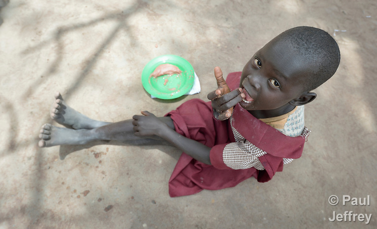 A child enjoys lunch in the Loreto Primary School in Rumbek, South Sudan. The Loreto Sisters began a secondary school for girls in 2008, with students from throughout the country, but soon after added a primary in response to local community demands.