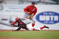 Batavia Muckdogs second baseman Samuel Castro (5) is tagged out by second baseman Jake Scheiner attempting to steal second during a game against the Williamsport Crosscutters on August 3, 2017 at Dwyer Stadium in Batavia, New York.  Williamsport defeated Batavia 2-1.  (Mike Janes/Four Seam Images)