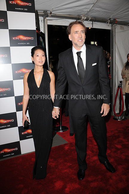 WWW.ACEPIXS.COM . . . . . ....March 9 2009, New York City....Actor Nicolas Cage and Alice Kim arriving at the premiere of 'Knowing' at the AMC Loews Lincoln Square on March 9, 2009 in New York City.....Please byline: KRISTIN CALLAHAN - ACEPIXS.COM.. . . . . . ..Ace Pictures, Inc:  ..tel: (212) 243 8787 or (646) 769 0430..e-mail: info@acepixs.com..web: http://www.acepixs.com
