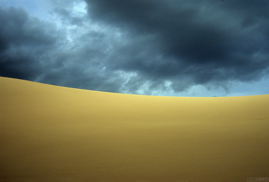 Sky and sand meet under stormy skies in Colorado's Great Sand Dunes National Park.