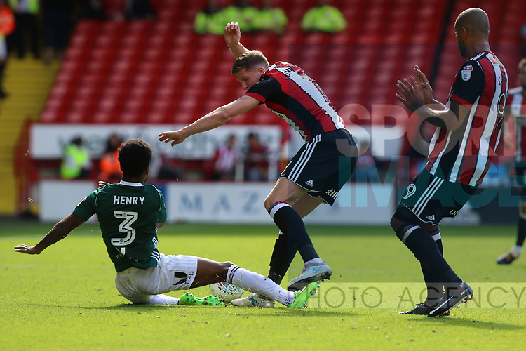 Rico Henry of Brentford in action with John Lundstram of Sheffield Utd during the English championship league match at Bramall Lane Stadium, Sheffield. Picture date 5th August 2017. Picture credit should read: Jamie Tyerman/Sportimage