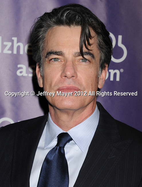 BEVERLY HILLS, CA - MARCH 21: Peter Gallagher arrives at the 20th Anniversary Alzheimer's Association 'A Night At Sardi's' at The Beverly Hilton Hotel on March 21, 2012 in Beverly Hills, California.