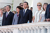 United States Secretary of Veterans Affairs Eric Shinseki, center,  looks on prior to U.S. President Barack Obama's remarks during a Memorial Day event at Arlington National Cemetery, May 26, 2014 in Arlington, Virginia. President Obama returned to Washington Monday morning after a surprise visit to Afghanistan to visit U.S. troops at Bagram Air Field. <br /> Credit: Drew Angerer / Pool via CNP