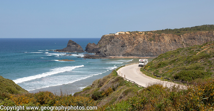 Motorhome parked at viewpoint of Atlantic Ocean waves breaking on rocky headland and bay with sandy beach, Praia de Odeceixe, Algarve, Portugal, Southern Europe