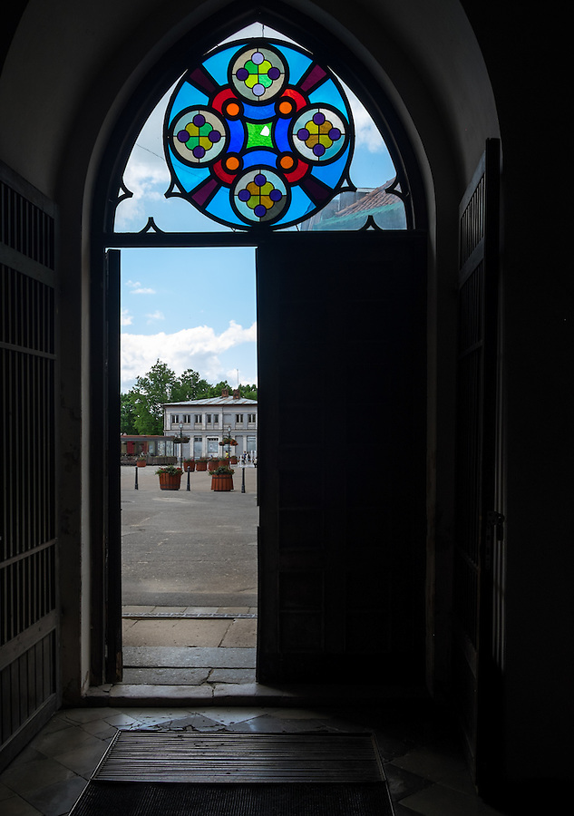 LATVIA, CESIS - CIRCA JUNE 2014: View of entrance and stained glass artwork of the St. John's Church in Cesis in Latvia.