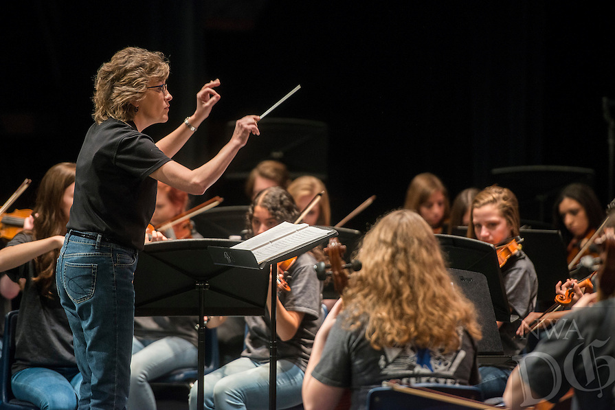 NWA Democrat-Gazette/ANTHONY REYES &bull; @NWATONYR<br /> Greta Lane, orchestra director for Rogers High School, conducts the, Music Appreciation in Rogers Schools Orchestra, Tuesday, Feb. 2, 2016 for fifth graders about to enter middle school at Rogers High School auditorium in Rogers. The Rogers Show Choir also performed. In between songs at the concert different instruments were brought forward and highlighted for the students to generate interest in joining the orchestra, band or choir in middle school.
