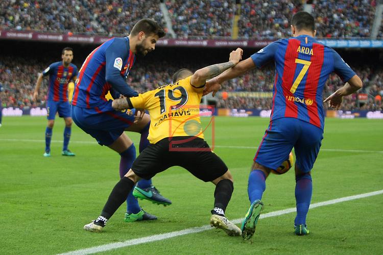 League Santander 2016/2017. Game: 12.<br /> FC Barcelona vs Malaga CF: 0-0.<br /> Gerard Pique, Sandro Ramirez &amp; Arda Turan.