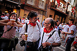 The photographer Associated Press Alvaro Barrientos and retired photographer Joxe La Calle talk on the streets of Pamplona during the San Fermin Festival, on July 12, 2012, in Pamplona, northern Spain. The festival is a symbol of Spanish culture that attracts thousands of tourists to watch the bull runs despite heavy condemnation from animal rights groups . (c) Pedro ARMESTRE