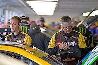 At work on Kyle Busch's, (#18) car