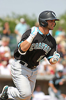The Coastal Carolina University Chanticleers second baseman Tommy La Stella #11 pumping his fist while running to 1st base after singling home a run during the 2nd and deciding game of the NCAA Super Regional vs. the University of South Carolina Gamecocks on June 13, 2010 at BB&T Coastal Field in Myrtle Beach, SC.  The Gamecocks defeated Coastal Carolina 10-9 to advance to the 2010 NCAA College World Series in Omaha, Nebraska. Photo By Robert Gurganus/Four Seam Images